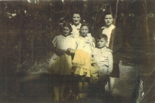 4a Taken on August 16 1943 in Brou with Mme Leroux and her daughter Edith back row and me my friend marcel and my brother Albert front row