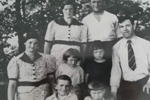 Jacob and his family. Standing in back: Jacob's mother, Rachel, and father, Yachel. In the middle row, from left to right: Jacob's aunt Leah; Jacob's brother Yossi and sister, Ethel; Jacob's uncle Moshe. Front row, from left to right: Jacob's brother, Elli, and Jacob. Lodz, 1938.