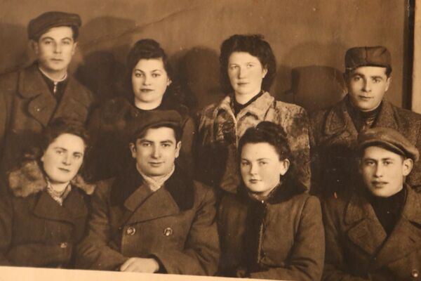 Lea, standing second from right, and a group of survivors at the DP camp. Gliwice, 1945.