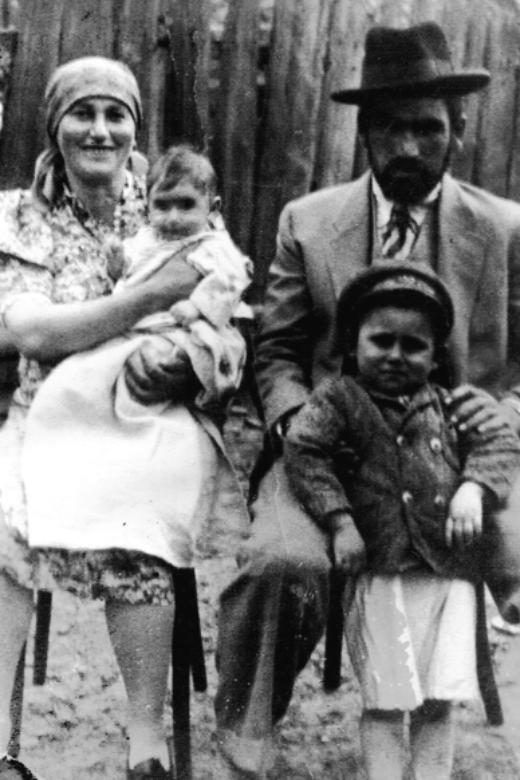 Yolanda's mother, Helen, holding one-year-old Yolanda and Yolanda's father, Ezra, with three-year-old Harry. Veréce, Czechoslovakia, 1938.