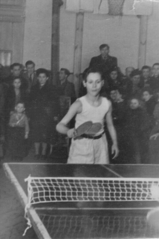 Phil playing ping pong after the war.
