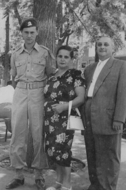 Philip (left), when he served in the Israel Defense Forces, standing with his mother, Iska, and stepfather, Kopel. Israel, circa 1950s.