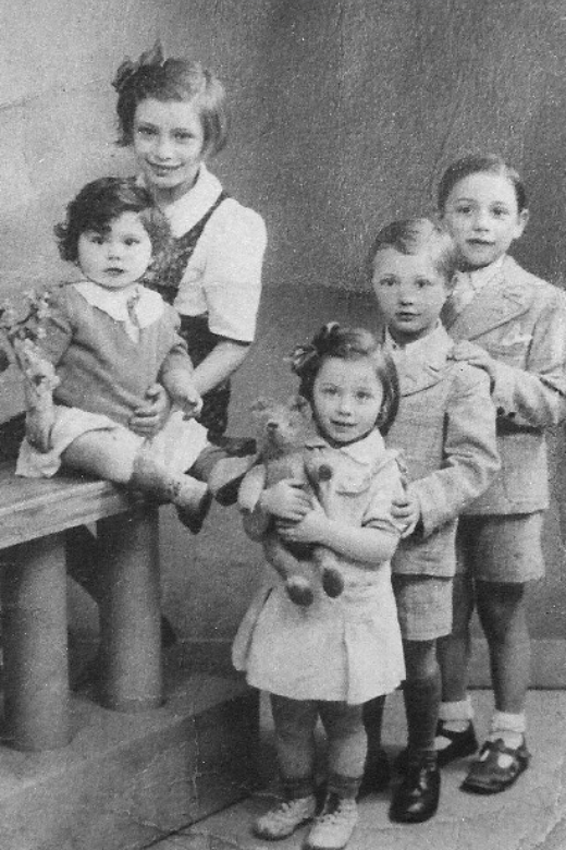 The Fikman children in Paris, circa 1940. On the left: Isabelle and Mireille (in front). On the right (back to front): Fernand, Maurice and Denise.