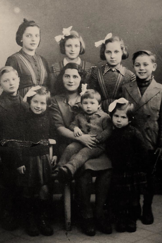 Perla with her six children and two nieces. Back row, left to right: Cécile Lis, Isabelle, Isabelle Lis, Maurice. Front row, left to right: Fernand, Denise, Perla, Monique, Mireille, c. 1943.