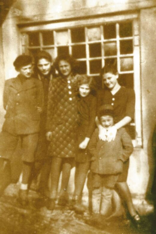 Edith (second from left) with her siblings. From left to right: Herman, Edith, Hilda, Ruth and Lea. In front is her younger brother, Itzhak. Humenné, Slovakia, 1938.